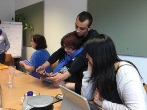 the participants are working with iPads