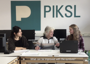 Three women sitting next to each other in front of one Computer at PIKSL.
