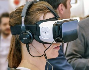 A young girl with VR glasses and a headset
